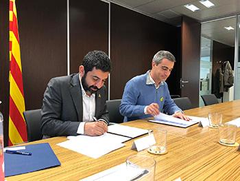 Foto de la signatura del conveni