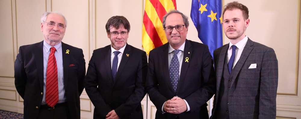Catalan president Quim Torra and former president Carles Puigdemont speak in Brussels on the topic
