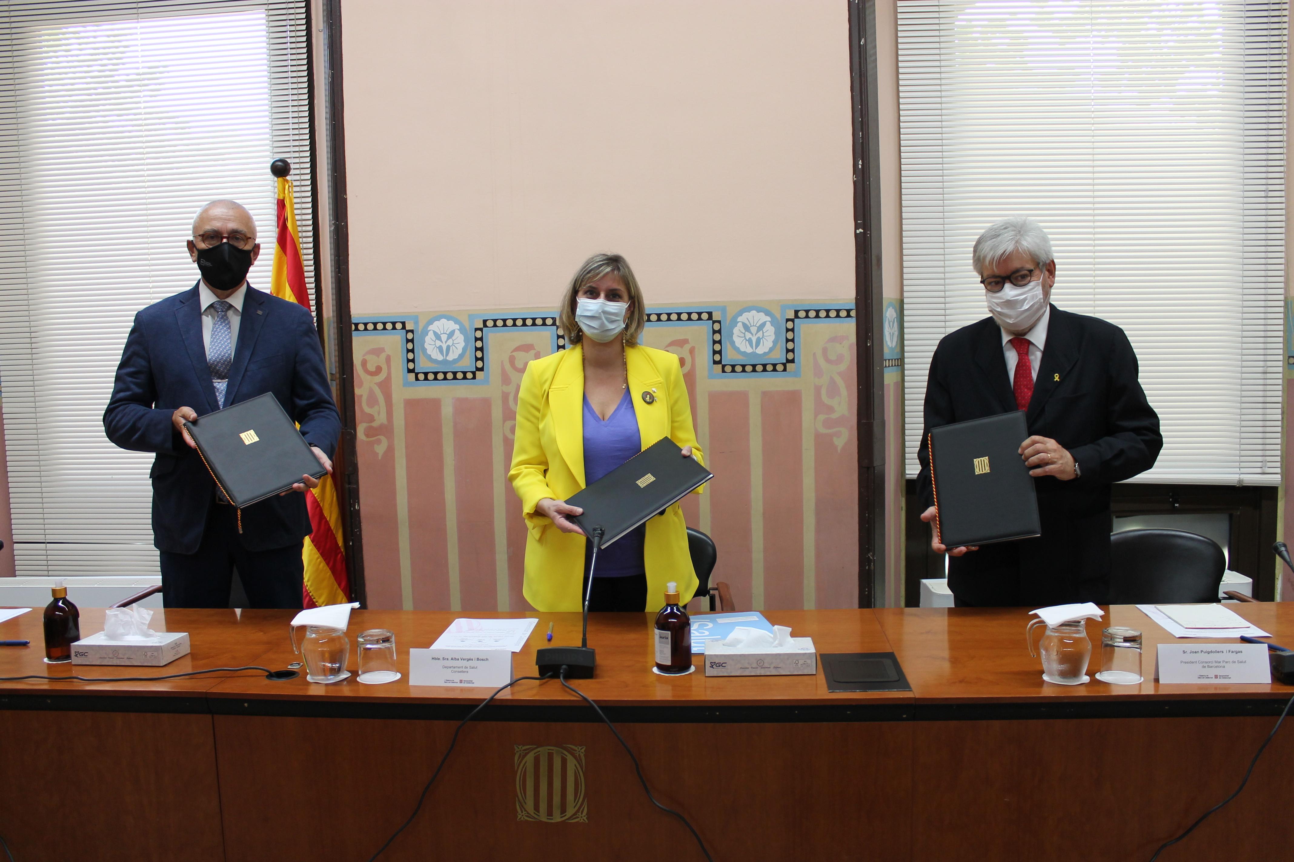 Casals, Vergés i Puigdollers, després de signar el conveni.