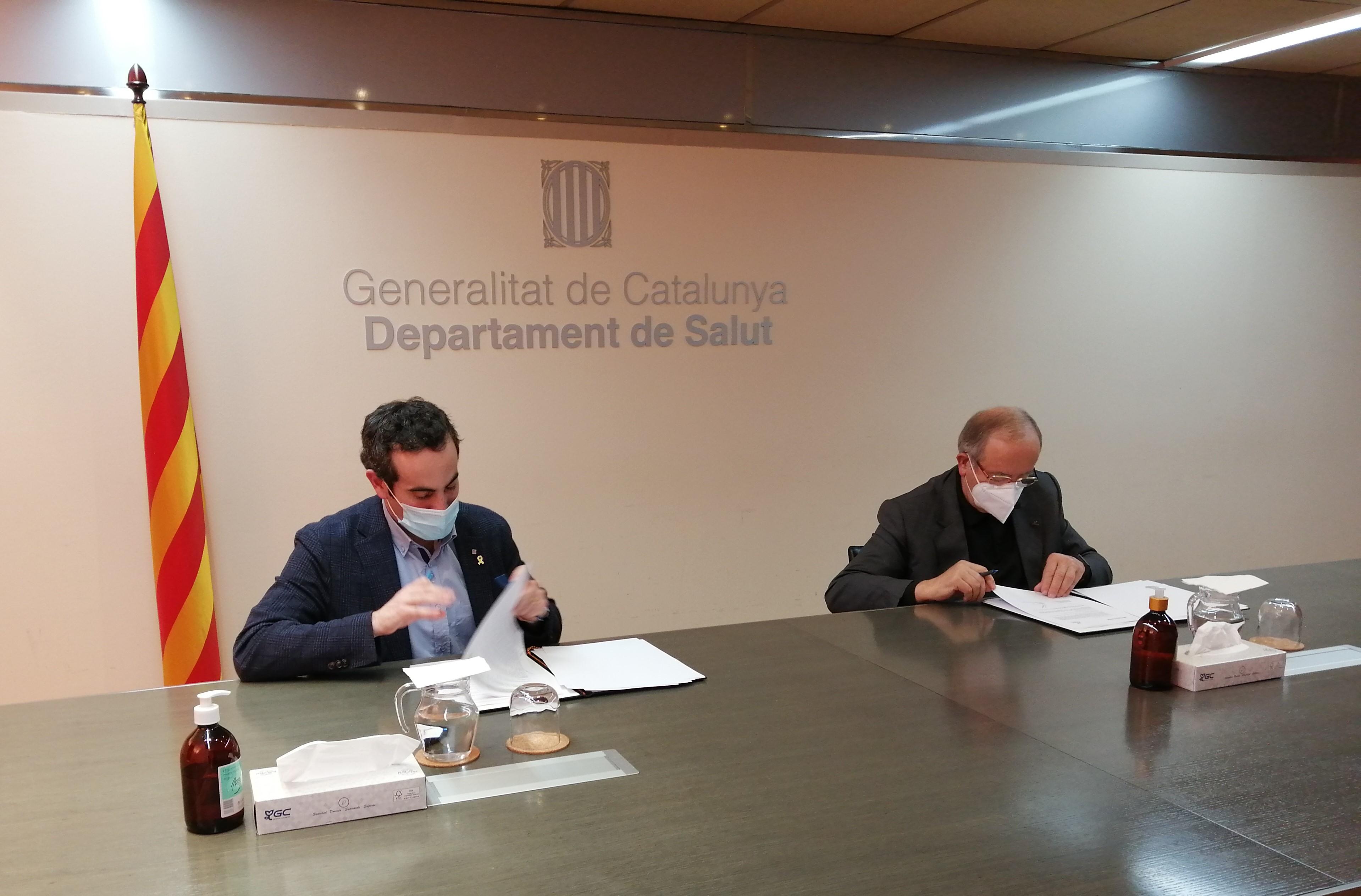 Signatura del conveni, entre Ramentol i González, ahir al vespre