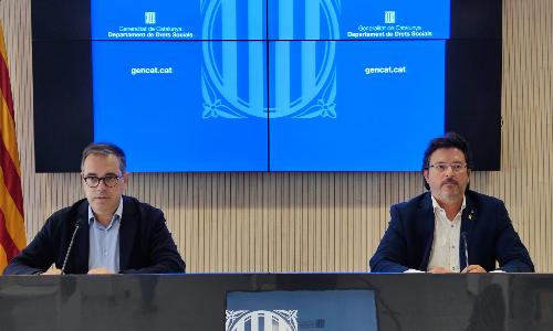 Els secretaris Carles Sala i Isidre Gavin en la roda de premsa de balanç de la Llei de barris